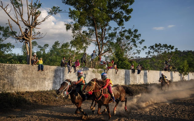 A horse race in Bima, on the Indonesian island of Sumbawa, where child jockeys are a longstanding tradition, Jul 8, 2019. The New York Times