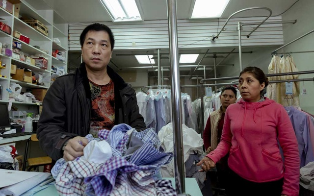 Ricarda, right foreground, addresses her employer, Huanxin Chen, left, during a protest at Sunshine Shirt Laundry Centre in Bay Ridge, Brooklyn, on Feb 16, 2019. The New York Times