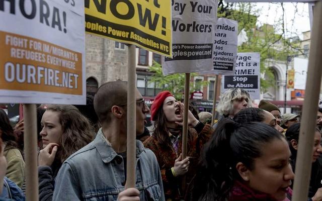 Protesters outside TYS Laundromat in East Harlem, on May 1, 2019. A survey conducted by the Laundry Workers Centre found that one in five workers was paid below minimum wage, while 36 percent of them did not receive proper overtime compensation. The New York Times