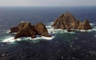FILE PHOTO: An aerial view shows a part of the group of islets known in South Korea as Dokdo and in Japan as Takeshima in the Sea of Japan, Oct 20, 2007. REUTERS/Yuri Maltsev