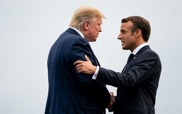 President Emmanuel Macron of France welcomes President Donald Trump to the opening dinner of the G-7 summit in Biarritz, France, Aug 24, 2019. The New York Times