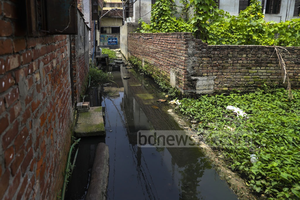 Haji Lal Mia Lane at North Muradpur in Dhaka's Kadamtali can be mistaken for anything from a water body to garbage dumping site. This horrible condition for the residents of the area due to waterlogging has been continuing for around three years. Photo: Abdullah Al Momin