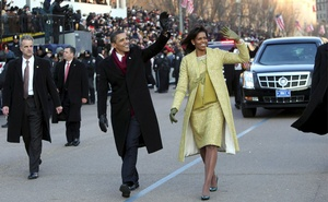 President Barack Obama and first lady Michelle Obama, wearing a two-piece lemongrass-hued ensemble designed by the Cuban-American designer Isabel Toldeo, walk down Pennsylvania Avenue toward the White House during his inauguration, in Washington, Jan 20, 2009. The New York Times