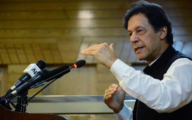 FILE PHOTO: Pakistani Prime Minister Imran Khan gestures as he addresses the Azad Kashmir parliament on Pakistan's 72nd Independence Day in Muzaffarabad, Pakistan-administered Kashmir, Aug 14, 2019. REUTERS
