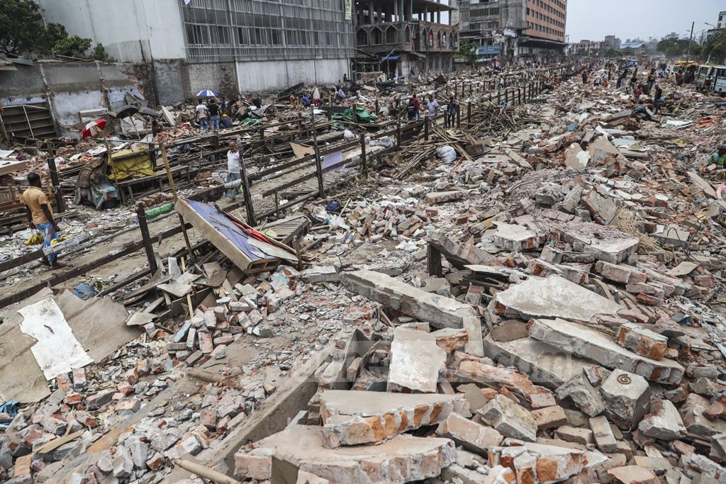 Piles of debris on both sides of the Dhaka-Narayanganj tracks remain on Wednesday after after the authorities demolished markets that were set up illegally by encroaching on Bangladesh Railway land on Monday. Photo: Abdullah Al Momin