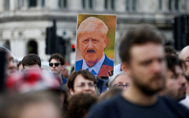 Man wearing a mask of Boris Johnson: A man wearing a mask of British Prime Minister Boris Johnson, protests outside Downing Street in London, Britain Aug 28, 2019. REUTERS