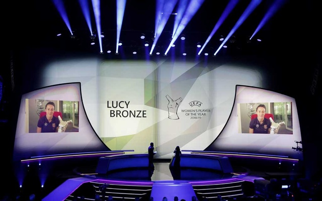 England's Lucy Bronze is presented with the UEFA Women's Player of the Year award. Football - Champions League Group Stage draw - Grimaldi Forum, Monaco - August 29, 2019. Reuters