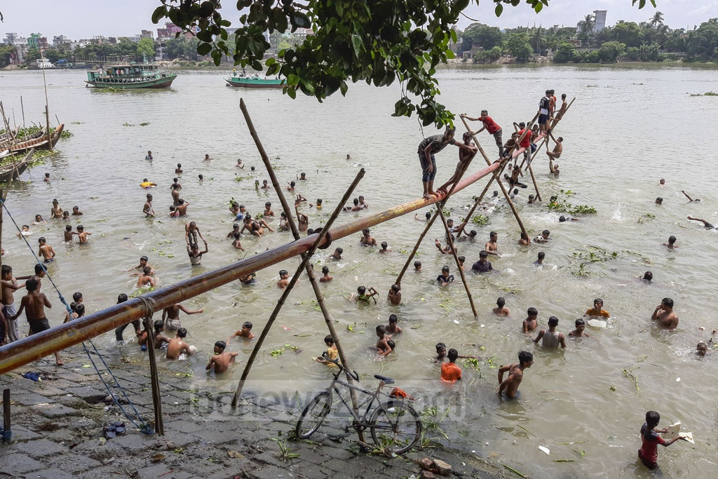 The water of the Buriganga river in Dhaka is relatively clean now after monsoon rains. These photos show children playing in the river under the sweltering sun in Kamrangirchar on Friday. Photo: Abdullah Al Momin