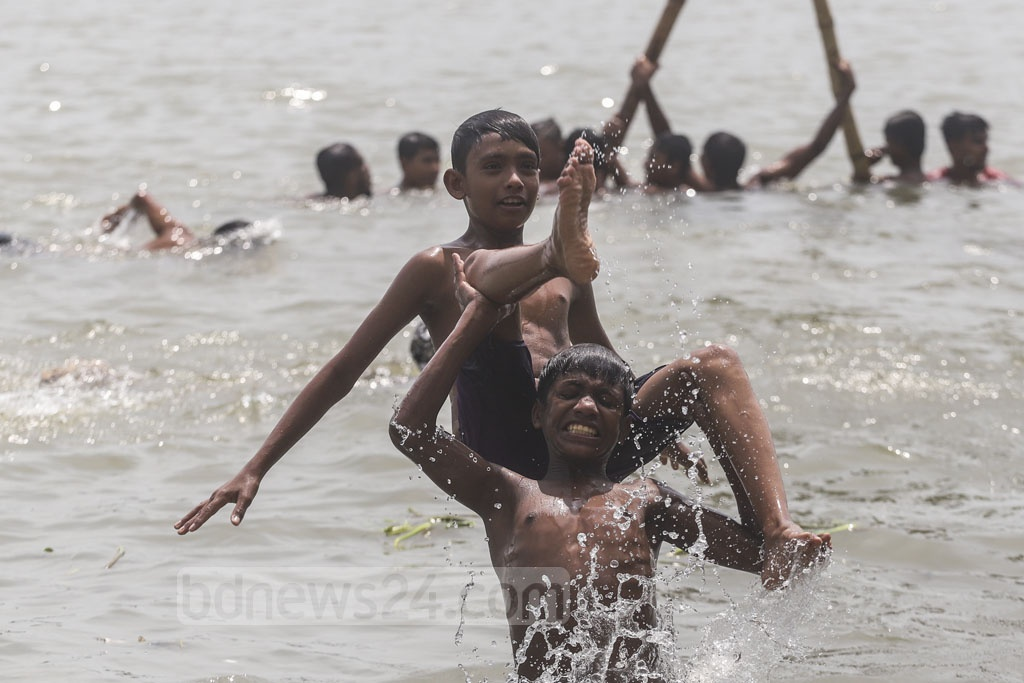 Children playing in the Buriganga river at Kamrangirchar in Dhaka on Friday as the water gets relatively clean after monsoon rains. Photo: Abdullah Al Momin