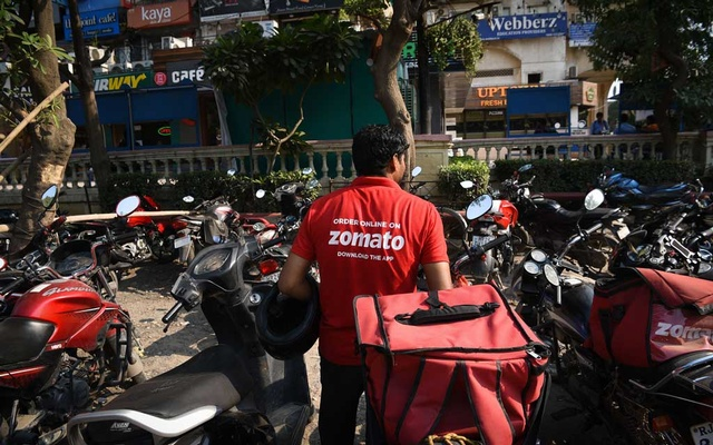 A Zomato delivery agent parks his bike before collecting a delivery order at a restaurant in the Galleria Market in Gurugram, India, a New Delhi suburb home to many tech companies including Zomato, on Aug. 27, 2019. Frustrated by the steep commissions and discounts that apps like Zomato and Uber Eats push on restaurants, thousands have started a movement to #Logout from them. (Sahiba Chawdhary/The New York Times)