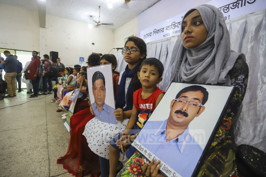 Adolescent family members hold photos of alleged of forced disappearance at a discussion in the National Press Club in Dhaka on Friday marking the International Day of the Victims of Enforced Disappearances. Photo: Asif Mahmud Ove