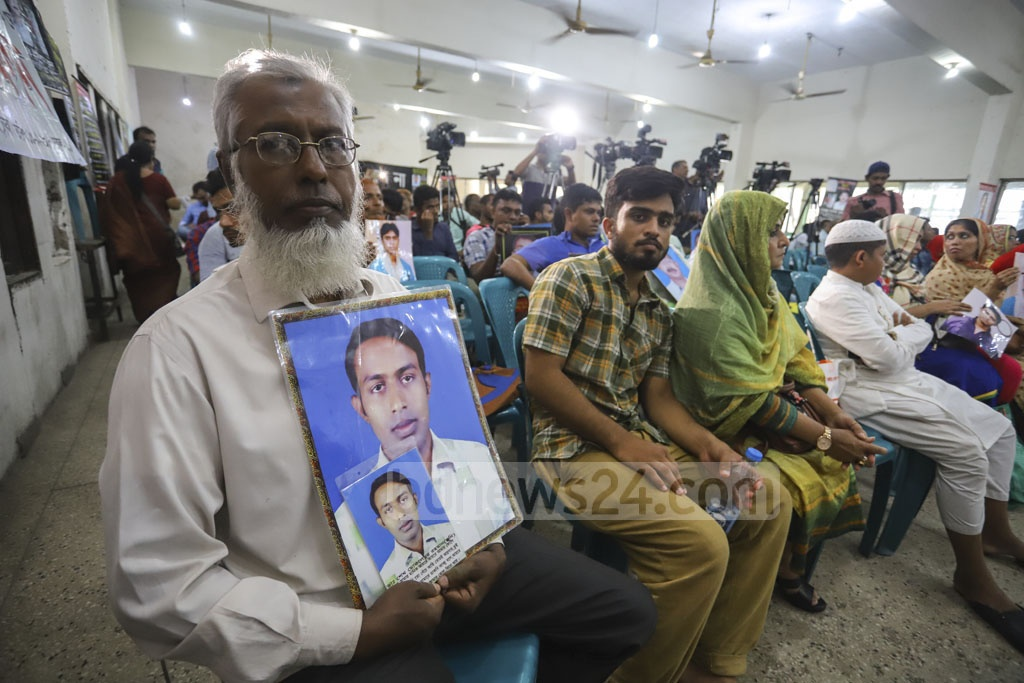 Families show photos of people, who are allegedly victims of enforced disappearance, at a discussion in the National Press Club in Dhaka on Friday marking the International Day of the Victims of Enforced Disappearances. Photo: Asif Mahmud Ove
