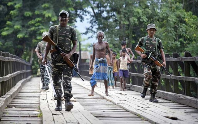 Indian security personnel patrol on a road ahead of the publication of the final draft of the National Register of Citizens (NRC) at Kachari Para village, in Hojai district, northeastern state of Assam, India August 30, 2019. Reuters