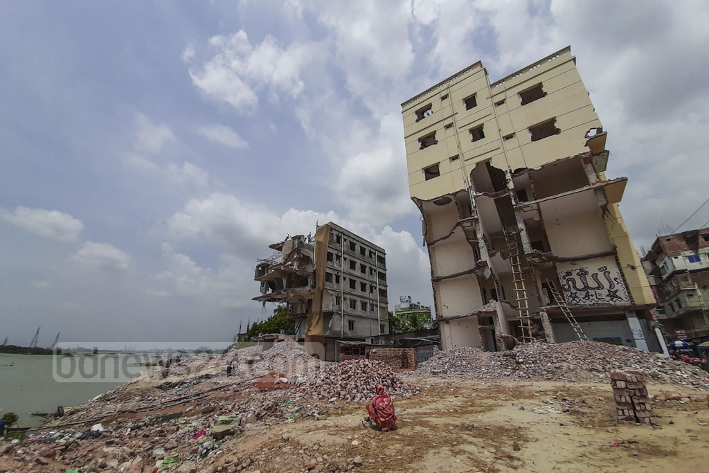 Parts of two illegal buildings were demolished by Bangladesh Inland Water Transport Authority or BIWTA during an eviction drive on the banks of the Buriganga River at Kholamora Ghat in Kamrangirchar in Januray. The debris from the structures has yet to be removed. The photo was taken on Saturday. Photo: Abdullah Al Momin