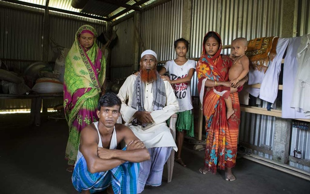 Najrul Islam, centre, and his family, who are Muslim and did not appear on a recent citizenship list, in Shyampur, India, Saturday, Aug 29, 2019.