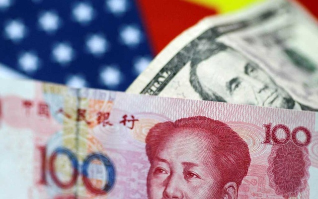 US dollar and China yuan notes are seen in this picture illustration Jun 2, 2017. REUTERS/Thomas White/Illustration/File Photo
