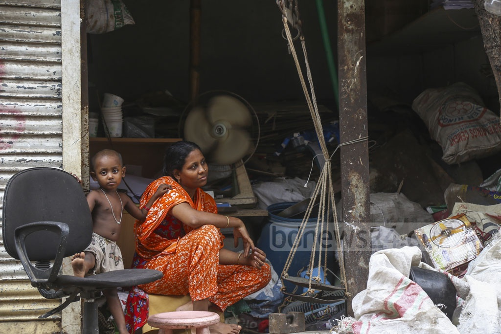 Jamila, mother of two-year old daughter Fatema, runs a store of unused goods at Korail slum in the Dhaka's Mohakhali area, creating scope for her husband to earn more from other sources. Photo: Mahmud Zaman Ovi