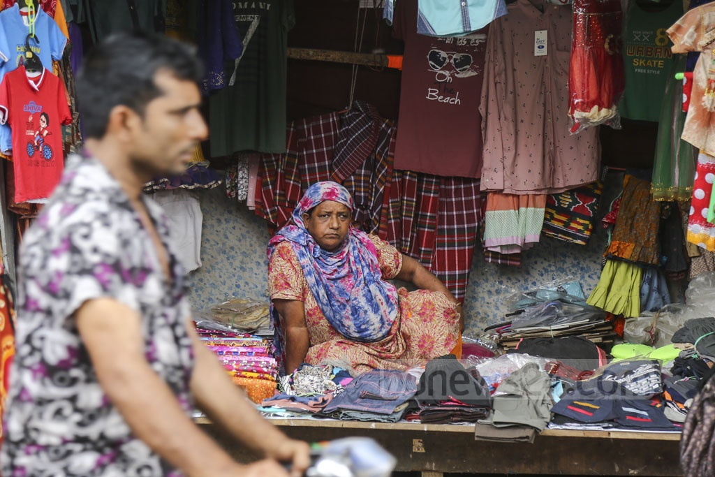 A woman operates a clothing store at Korail slum in the Dhaka's Mohakhali area on Monday. Photo: Mahmud Zaman Ovi