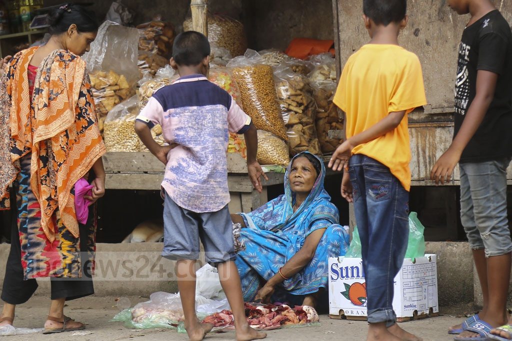 A woman sells fish at Korail slum in the Dhaka's Mohakhali area on Monday. Photo: Mahmud Zaman Ovi