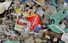 A sachet of Colgate toothpaste is pictured amidst a garbage-filled shore on Freedom Island, Paranaque City, Metro Manila, Philippines, Jul 15, 2019. REUTERS