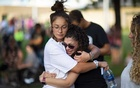 Cristina del Torro of San Antonio, right, cries and hugs a friend at a vigil for the victims of a mass shooting in Odessa, Texas, Sep 1, 2019. A city spokesman said seven people had been killed, in addition to the gunman. At least 21 others were wounded, including three law enforcement officers. The New York Times