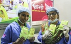 Volunteers displaying a pack of Bashanti sanitary napkins produced by Bidyanondo Foundation. A pack of the napkins is up for sale at Tk 5. Photo: Asif Mahmud Ove