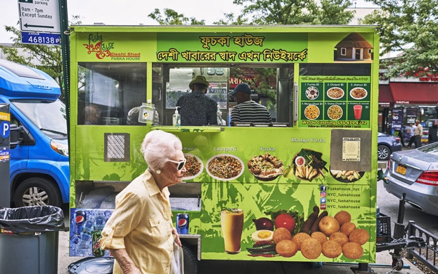 Fuskahouse, a Bengali snack cart that opened in January, in New York, Aug. 23, 2019. The cart is one of two on the same patch of turf, both with virtually identical menus, headlined by fuchka, a Bengali snack that is kin to gol gappa in India's north and pani puri in the west and south. (An Rong Xu/The New York Times)