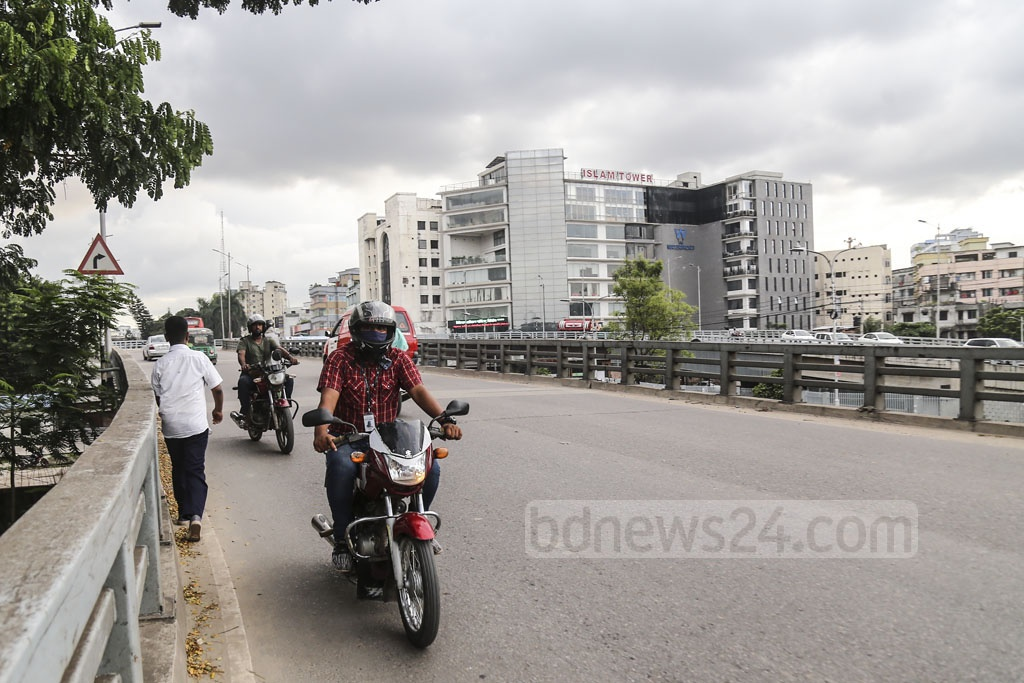 A motorcyclist defies a ban as he comes from the opposite direction in the Dhaka's Rampura U-loop. Photo: Mahmud Zaman Ovi