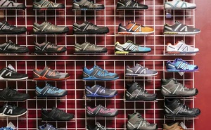 Shoes on display at the offices of Xero Shoes in Broomfield, Colo., Aug. 29, 2019. President Donald Trump's trade war is pressuring American companies to leave China, but many won't be able to move their supply chains home. (Benjamin Rasmussen/The New York Times)