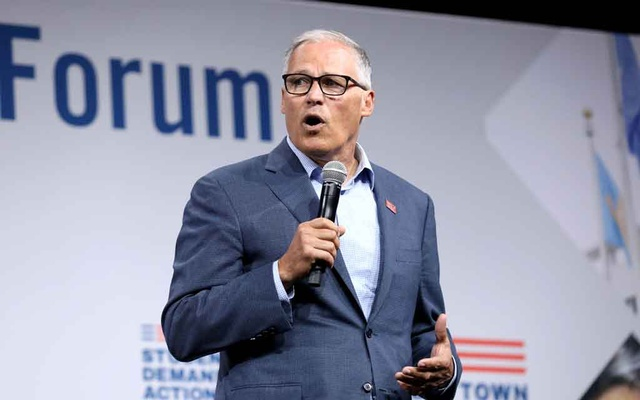 FILE PHOTO: 2020 Democratic US presidential candidate and Washington Governor Jay Inslee speaks during the Presidential Gun Sense Forum in Des Moines, Iowa, US, Aug 10, 2019. REUTERS
