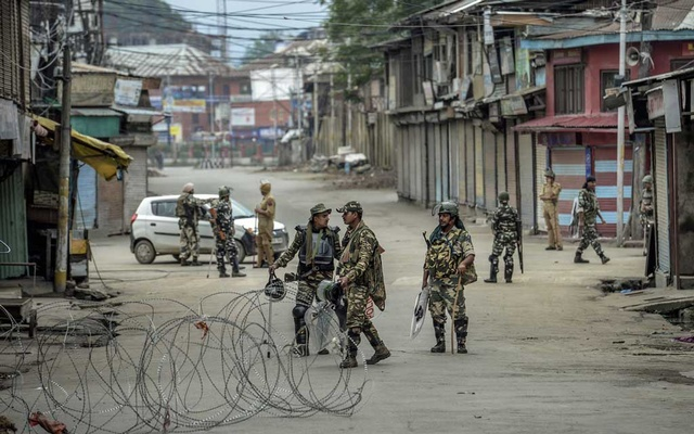 FILE PHOTO: Barbed-wire placed by security personnel stretches across a street in Srinagar, India, Aug 11, 2019. The Indian government cut off internet access in the Kashmir region in August and has halted everyday transactions. The New York Times