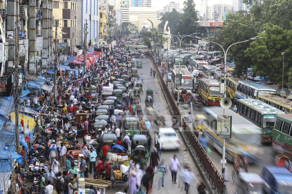 The hawkers illegally occupy half of the road, leaving narrow space for traffic. Photo: Asif Mahmud Ove