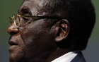 FILE PHOTO: Zimbabwean President Robert Mugabe addresses the Inaugural Session of the World Summit On Information Society in Geneva, Switzerland December 10, 2003. REUTERS