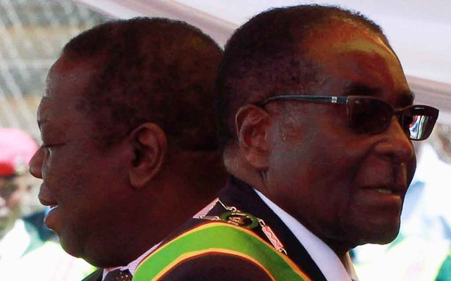 FILE PHOTO: Zimbabwean President Robert Mugabe (R) and Prime Minister Morgan Tsvangirai arrive at a rally marking Zimbabwe's 31st independence anniversary celebrations in Harare April 18, 2011. REUTERS