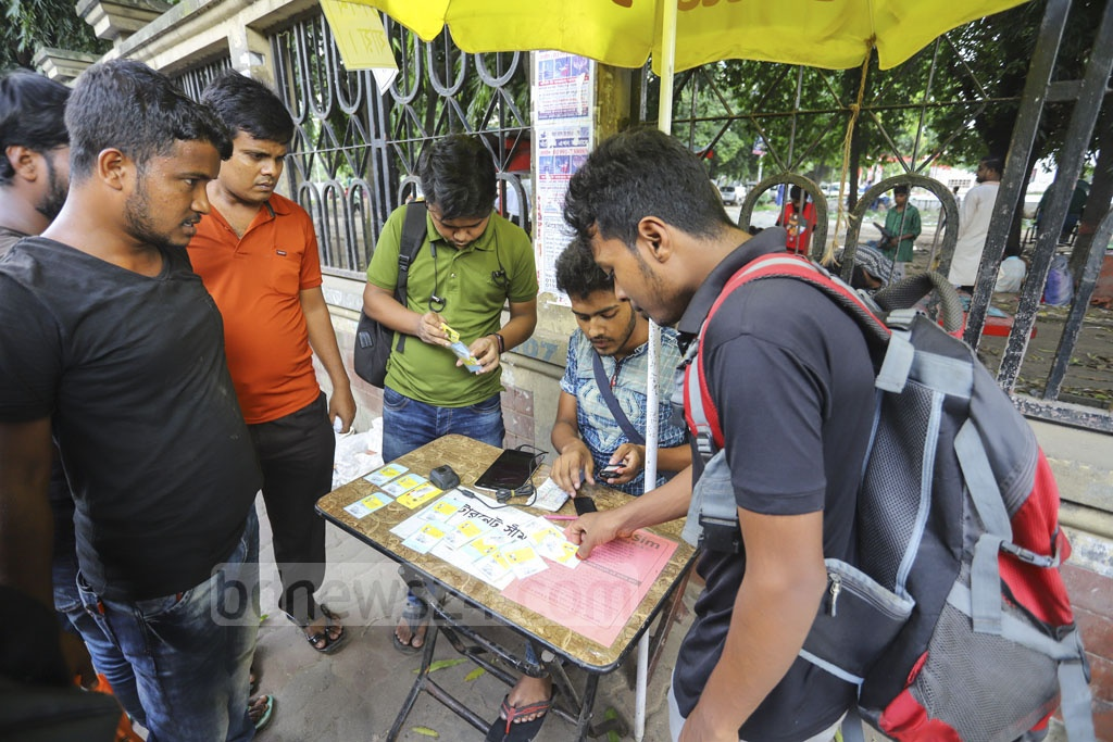A vendor selling mobile SIM cards on the side of a road in the capital's Gulistan. Photo: Asif Mahmud Ove