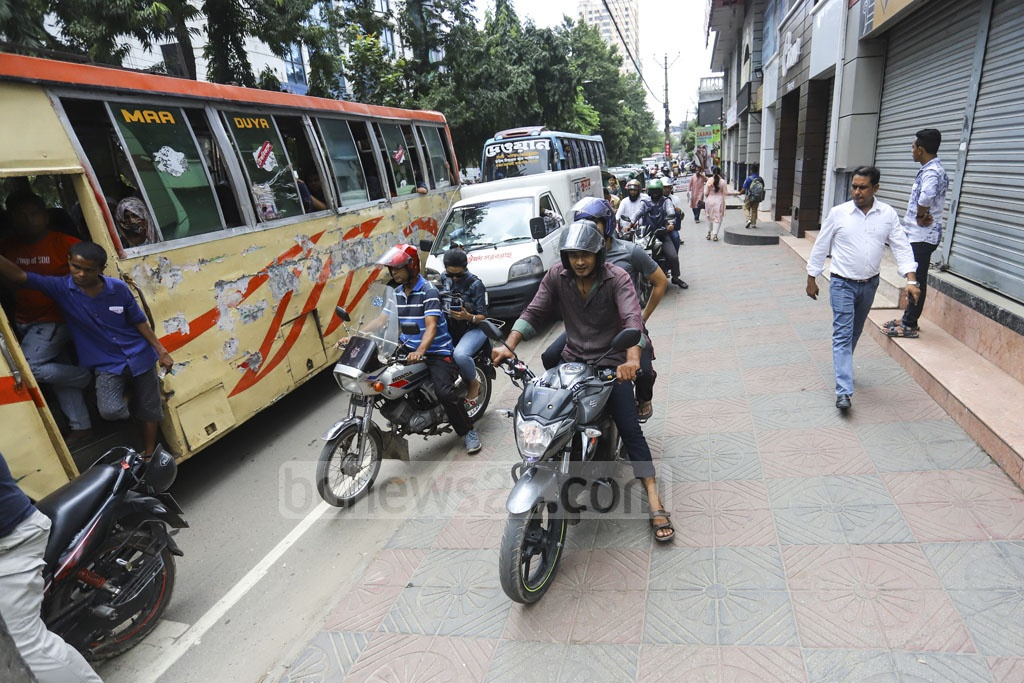 A three-month prison sentence has failed to deter motorcyclists as they continue to mount footpaths in the capital. In this photo clicked on Dhaka's Gulshan-Mohakhali Link Road, bikers are seen plying a footpath to beat the traffic. Photo: Asif Mahmud Ove