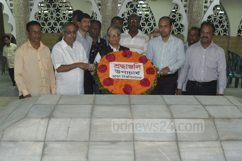 Dhaka University Vice-Chancellor Md Akhtaruzzaman placing a wreath on the grave of Huseyn Shaheed Suhrawardy on his 127th birth anniversary on Sunday.