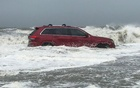 """A bagpiper went to the beach and played """"Amazing Grace"""" and """"Taps"""" for the stranded Jeep, which was the subject of much social media attention. The New York Times"""