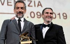 The 76th Venice Film Festival - Awards Ceremony - Venice, Italy, Sep 7, 2019 - Director Todd Phillips poses next to Joaquin Phoenix after winning the Golden Lion for Best Film. REUTERS/Piroschka van de Wouw