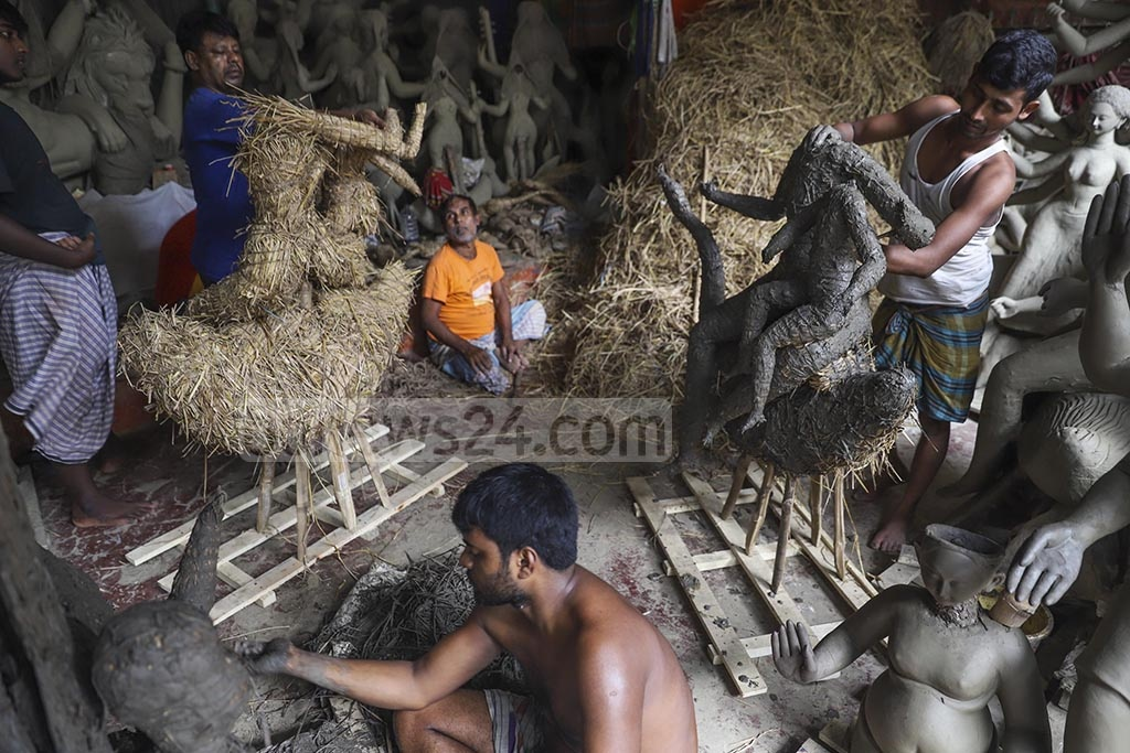 Ahead of Durga Puja, the largest festival for Hindus in Bangladesh, a craftsman is busy building idols of the goddess in Dhaka's Banglabazar on Monday. Photo: Abdullah Al Momin
