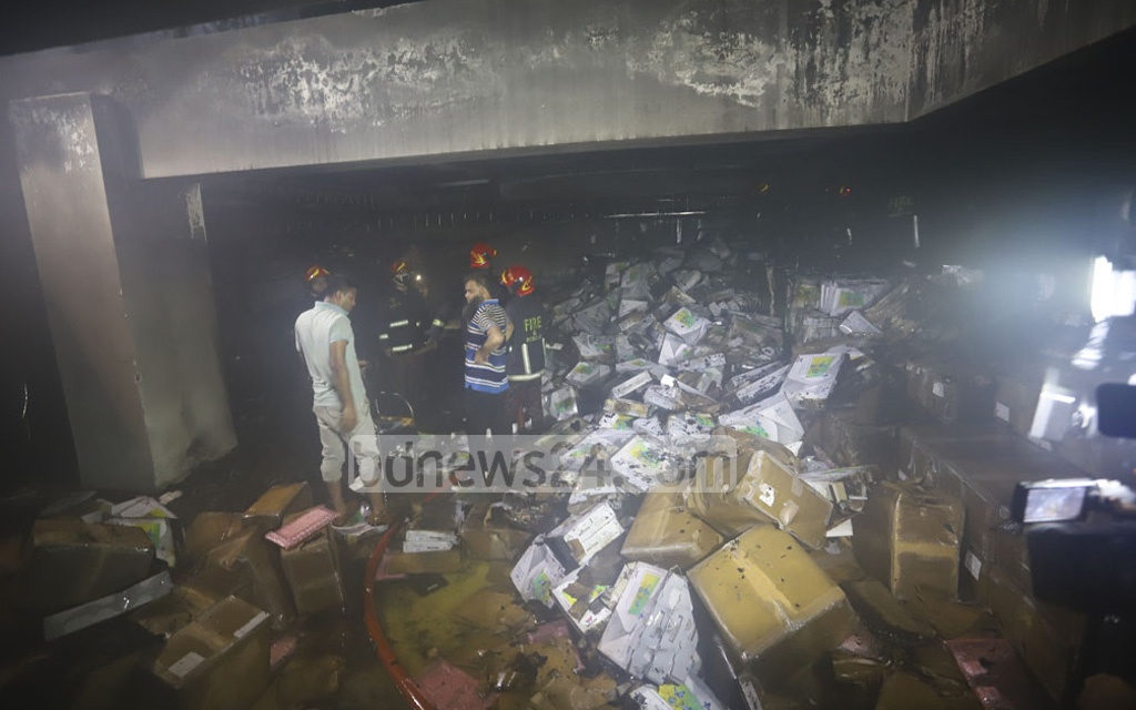A fire erupted in the basement of the Election Commission's headquarters in Dhaka's Agargaon Sunday late night. It damaged electronic voting machines or EVMs stored there before the firefighters were able to bring it under control after around an hour. Photo: Asif Mahmud Ove