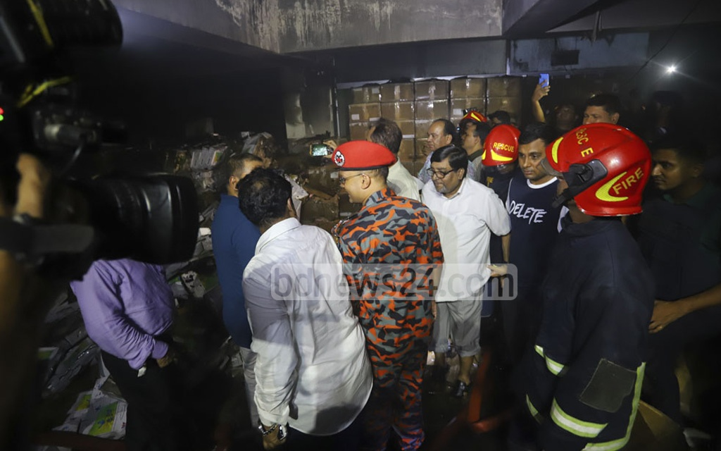 Election Commissioner Mahbub Talukdar visiting the basement of the commission's headquarters in Dhaka's Agargaon in the wee hours of Monday after a fire incident Sunday late night damaged electronic voting machines or EVMs stored there. Photo: Asif Mahmud Ove