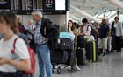 File Photo: People queue inside Terminal 5 at Heathrow Airport. Reuters