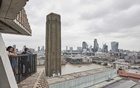 "File Photo: The view from the 10th-floor terrace of the Blavatnik Building at the Tate Modern gallery in London, Jun 22, 2017. A 6-year-old boy who was thrown from a balcony at the Tate Modern museum in London last month, suffering fractures and bleeding on the brain, is making ""amazing progress,"" his family says. The New York Times"