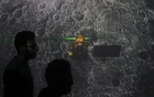Caption: File Photo: Student walk past a screen during a live streaming of Chandrayaan-2 landing at an educational institute in Mumbai, India, Sep 7, 2019. REUTERS