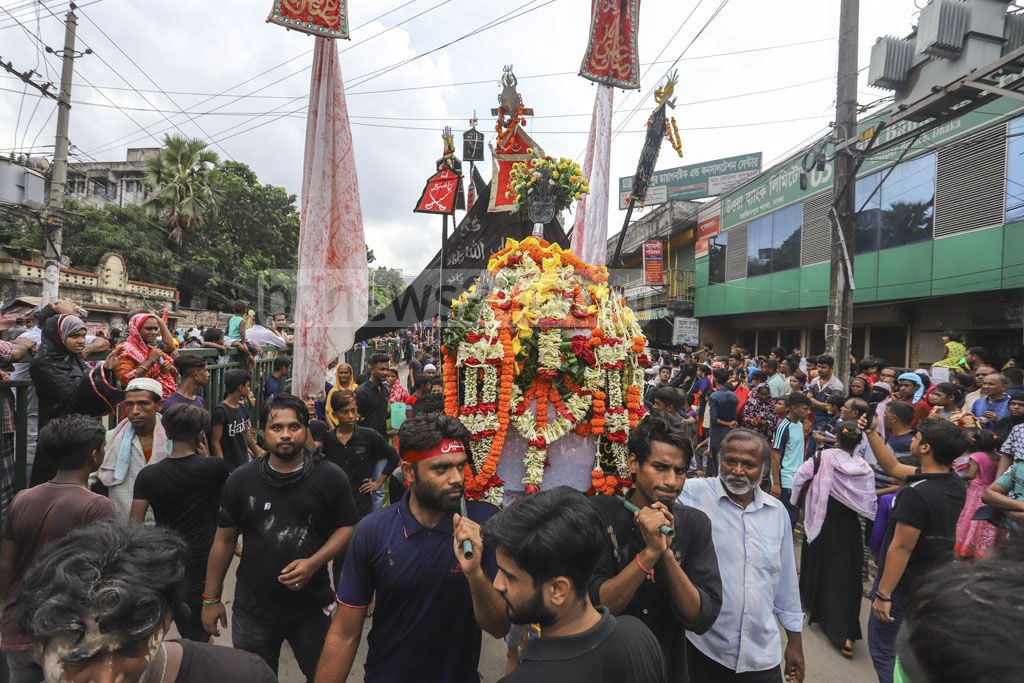 Shia Muslims flagging off the Tazia procession from Old Dhaka's Hossaini Dalan Imambara on Tuesday to observe Ashura in remembrance of the martyrdom of the Prophet's grandson Imam Hussain in Karbala. Photo: Asif Mahmud Ove