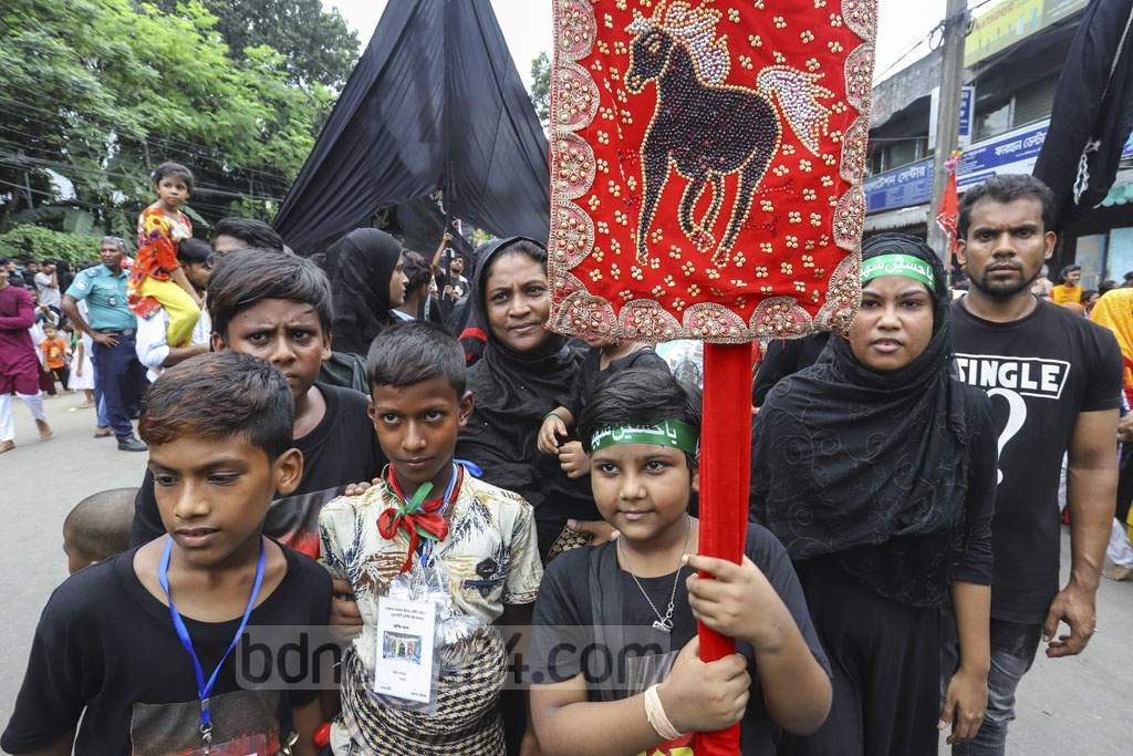 Shia Muslims in Bangladesh and around the world are observing Ashura on Tuesday, in remembrance of the martyrdom of Imam Hussain, the grandson of Prophet Muhammad in Karbala. Shia Muslims in the capital's Old Dhaka brought out the Tazia procession amid heightened security measures. Photo: Asif Mahmud Ove