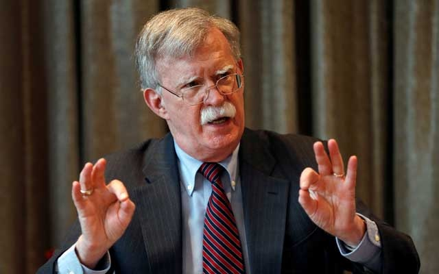 FILE PHOTO: US national security adviser John Bolton gestures as he meets with journalists during a visit to London, Britain August 12, 2019. REUTERS