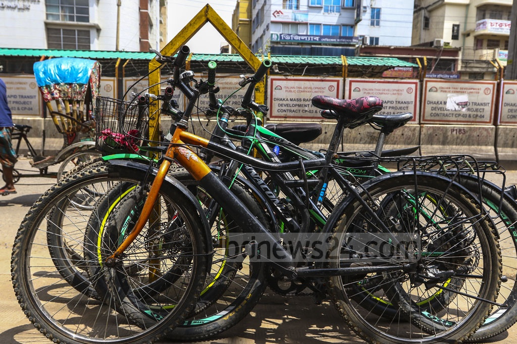 This photo clicked on a footpath in the capital's Mirpur-12 depicts an empty frame of a city corporation dustbin being used as a parking rack for bicycles. Photo: Mahmud Zaman Ovi