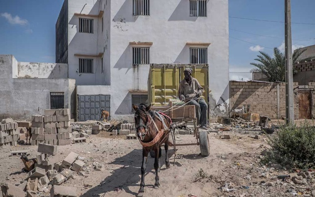 A horse-drawn cart is used for construction in Dakar, Senegal, Aug 17, 2019. The New York Times Caption 3: Carts and the horses used to pull them are parked in Dakar, Senegal, Aug 15, 2019. The New York Times